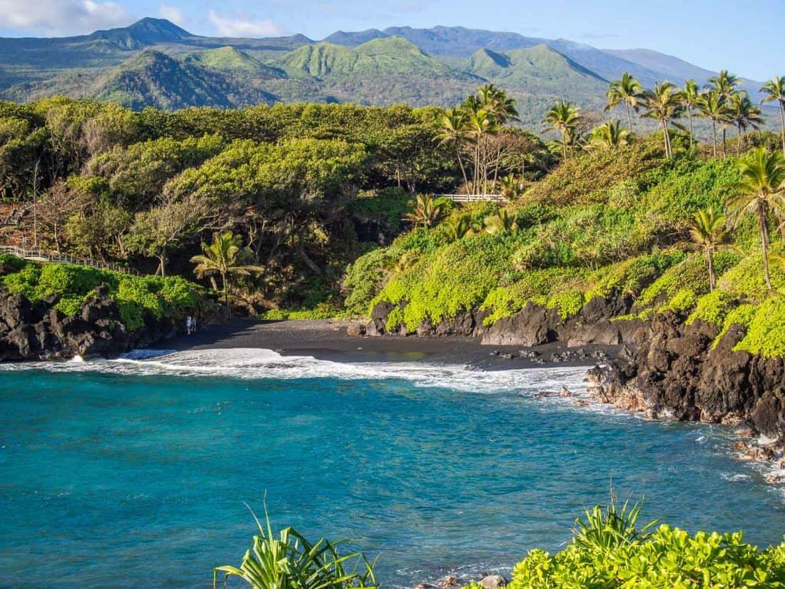 View of the black sand beach at Waianapanapa State Park near Hana from the coastal path above