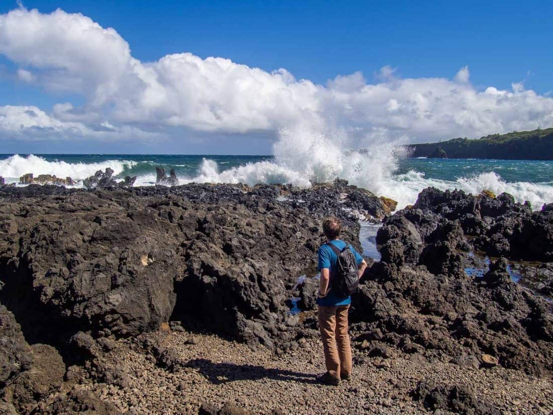 Simon watching waves crashing on rocks on the Ke'anae Peninsula in Maui