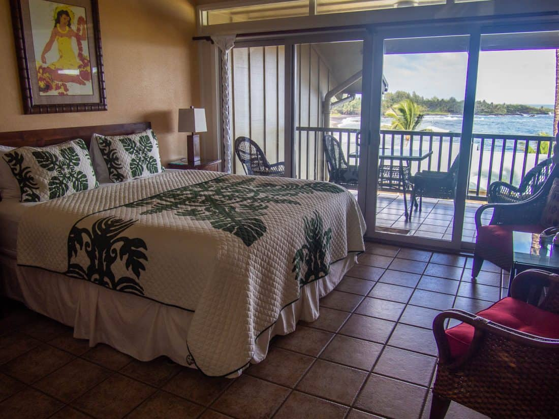 Bed, terrace and ocean view of condo 205 at Hana Kai in Maui