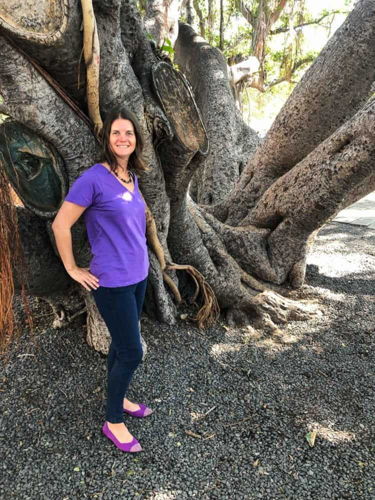 Erin wearing Rothys Point in mulberry by a banyan tree in Maui