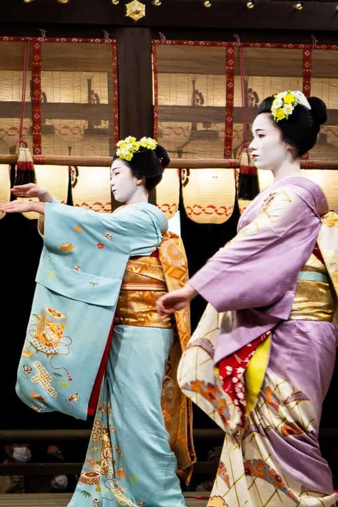 Geishas dancing at Yasaka shrine in Kyoto, Japan