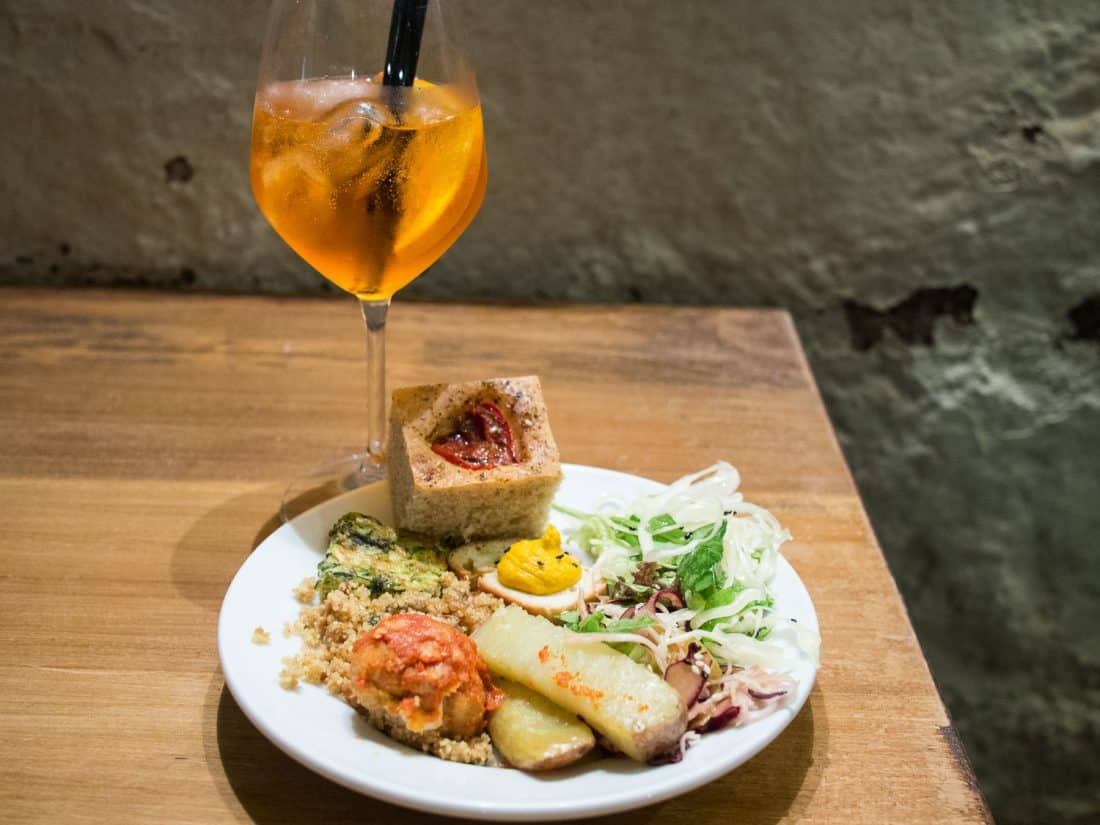 Spritz and a plate from the vegetarian aperitivo buffet at Ketumbar, Testaccio in Rome