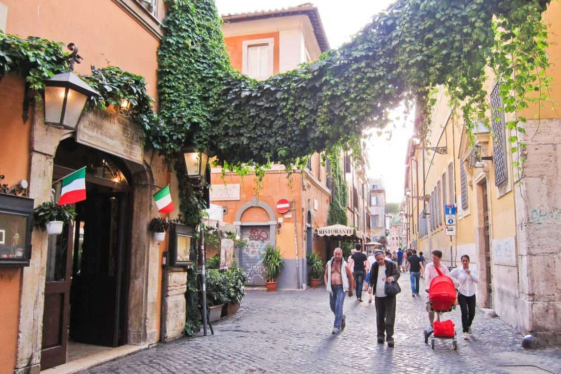 Trastevere street dripping with ivy- one of the best areas to stay in Rome