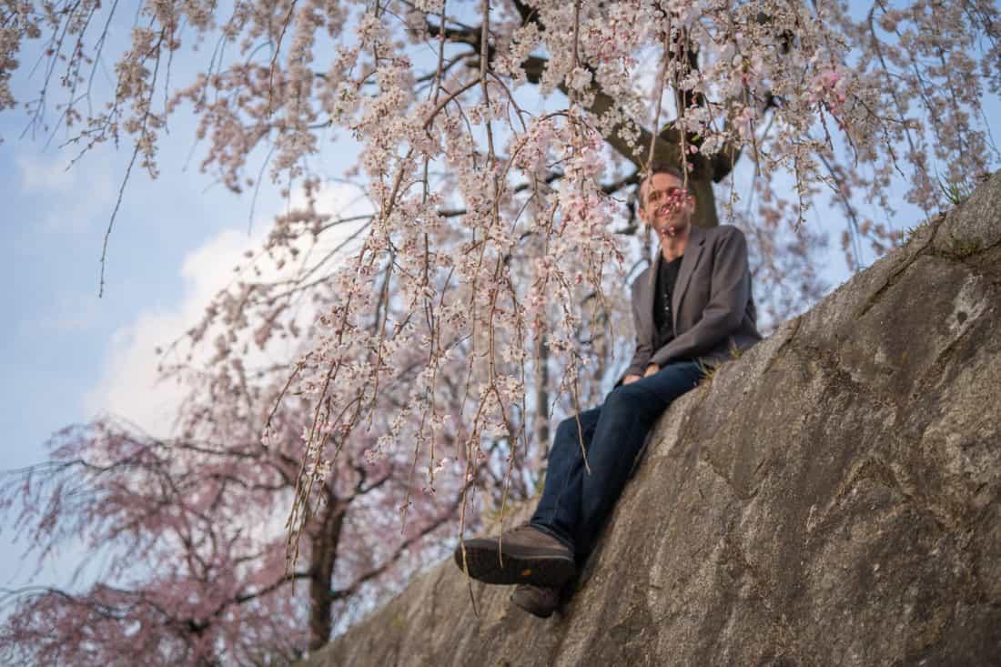 Simon amongst the Kyoto cherry blossoms along the Kamo River