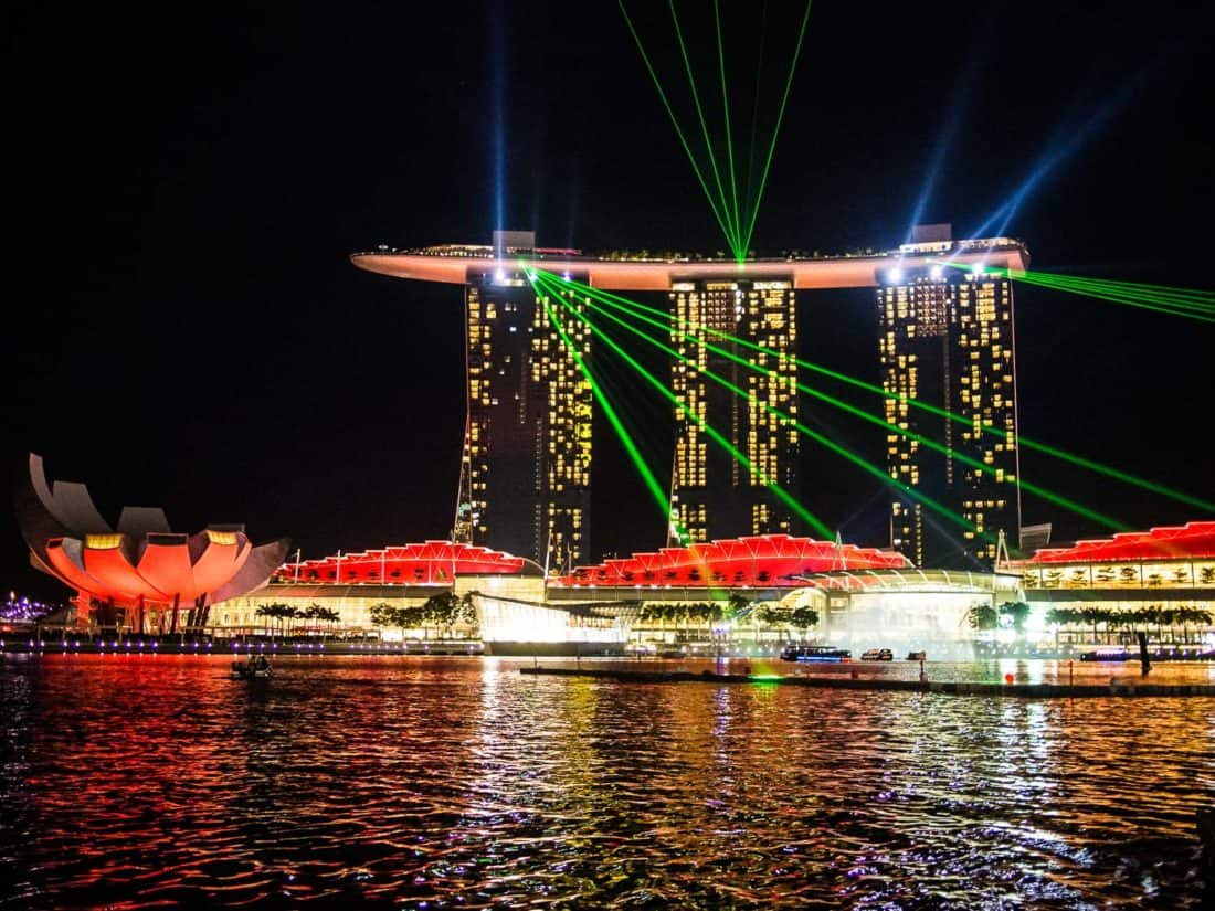 Spectra light show from the Merlion fountain with laser beams from Marina Bay Sands