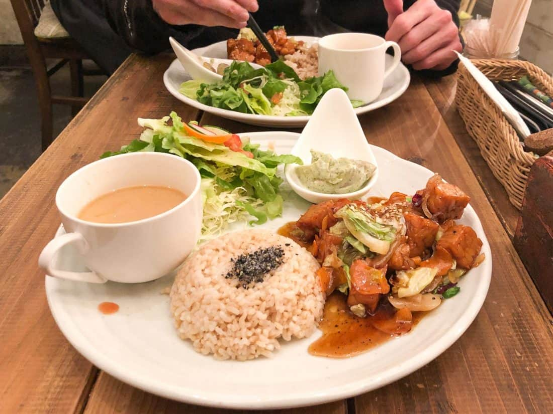 Lunch set with vegetable and tempeh teriyaki stir fry at Paprika vegan restaurant in Osaka, Japan