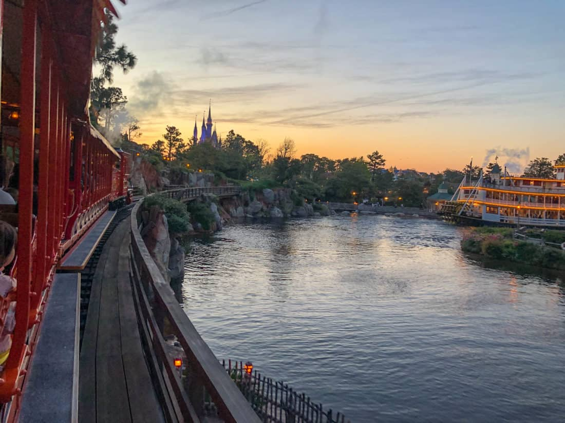 The view from Western River Railroad at Tokyo Disneyland at sunset of the Mark Twain Riverboat