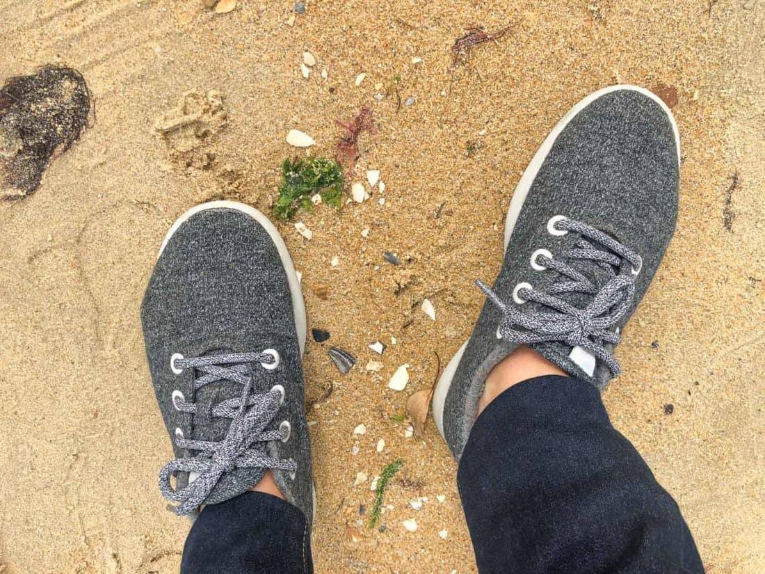 Allbirds Wool Runners in natural grey worn on the beach
