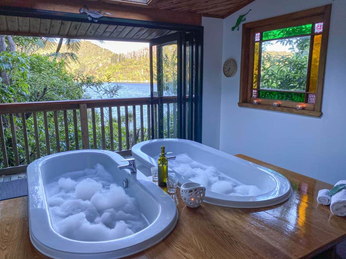 Side by side bubble baths in the private bathhouse at Lochmara Lodge in the Marlborough Sounds