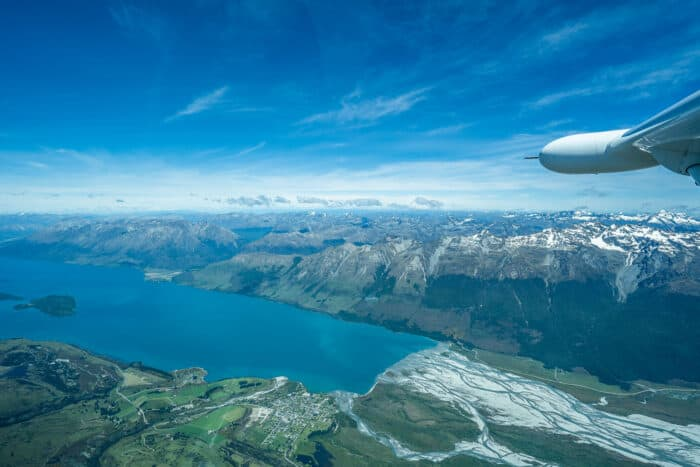 How to buy travel insurance when already abroad - flying over Queenstown, New Zealand