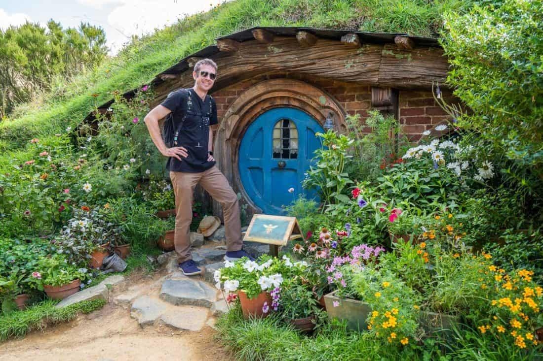 Simon at a Hobbit hole at Hobbiton movie set
