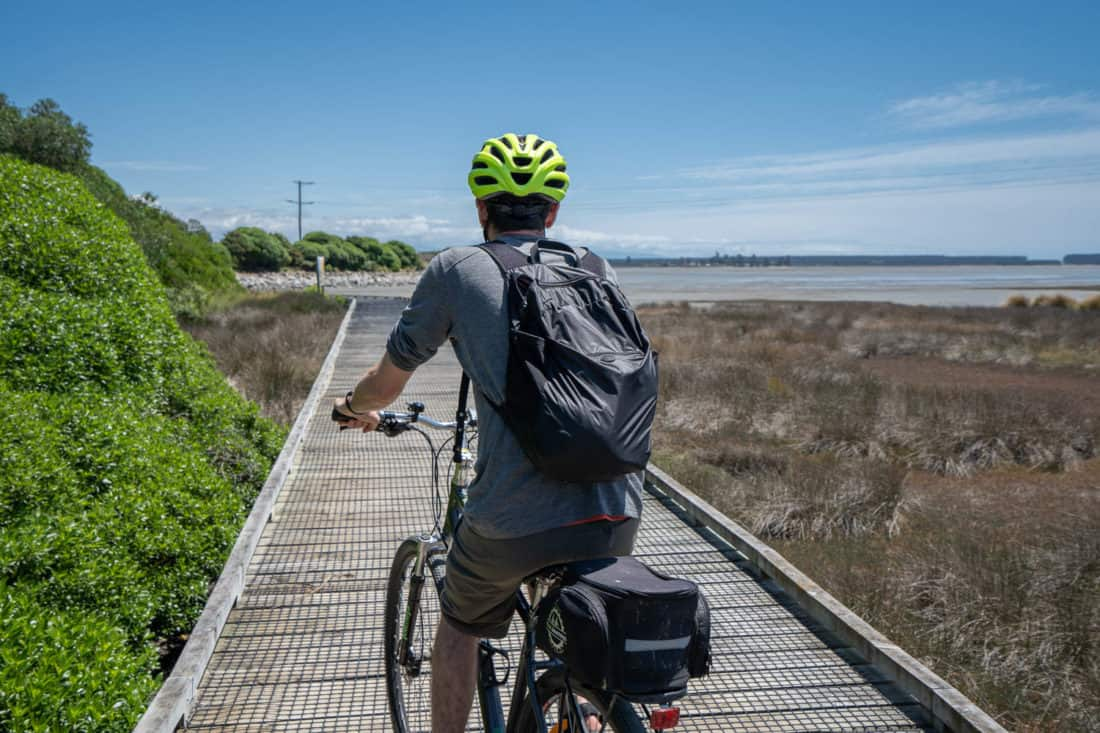 Cycling on the boardwalks on the Great Taste Trail from Nelson to Mapua