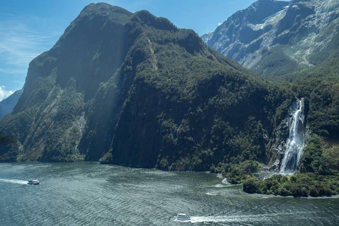 Flying over Bowen Falls in Milford Sound