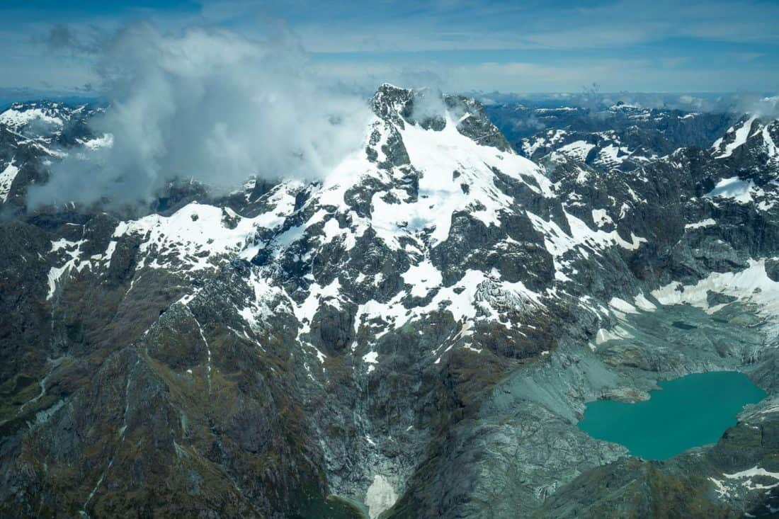 Glacial lake in the mountains on flight from Milford Sound to Queenstown