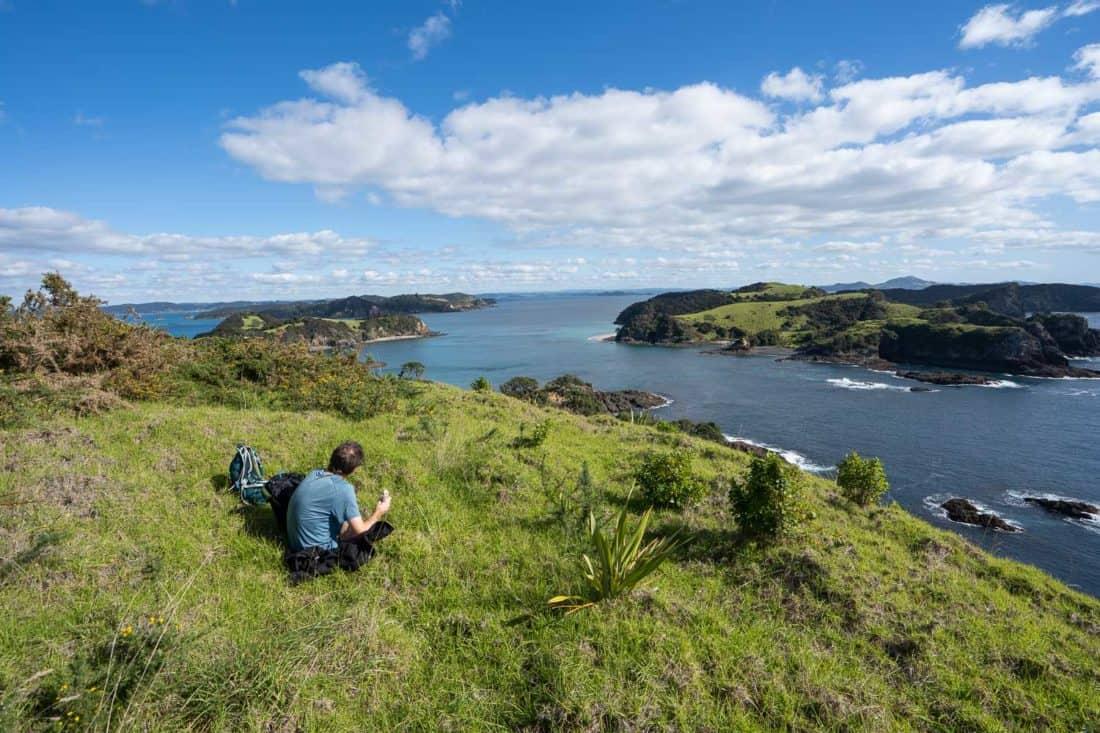 Eating lunch on the Cliff Pa Loop trail on Urupukapuka Island with views of Waewaetorea Island