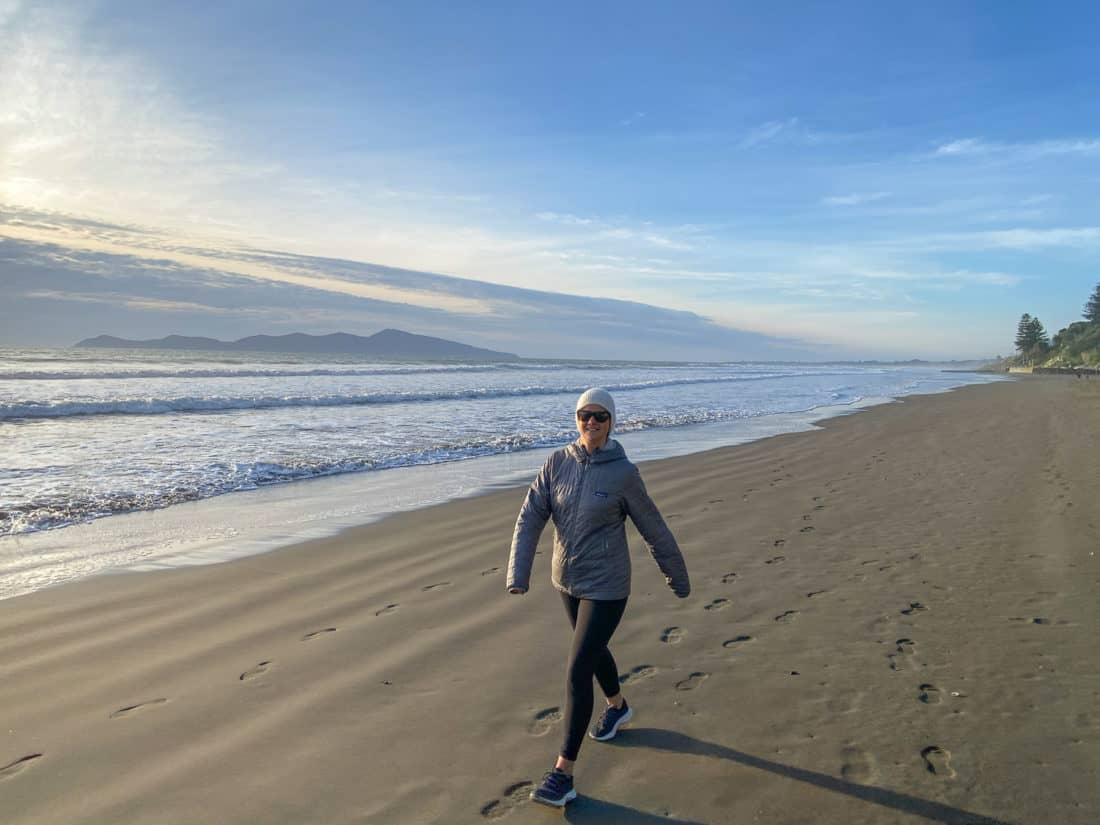 Erin walking on the beach in Allbirds Tree Dashers