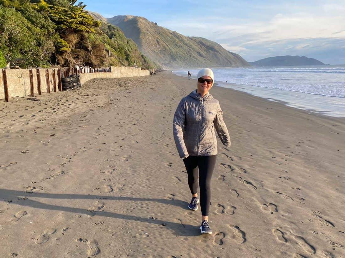 Erin walking on the beach in Allbirds Dashers
