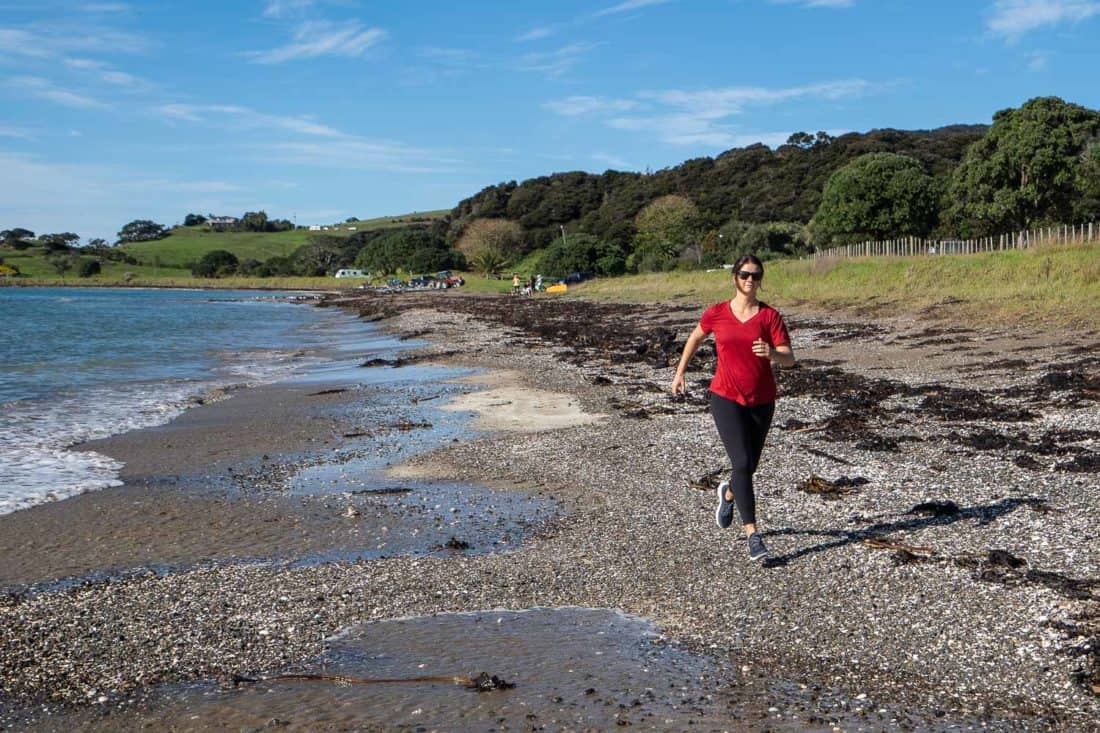 Erin running on the beach in Allbirds Dashers