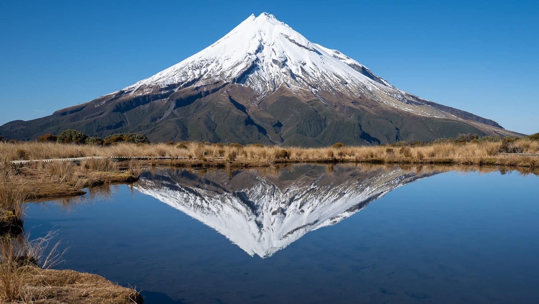 Reflection of Mount Taranaki in Pouakai Tarn, one of the best things to do in Taranaki New Zealand