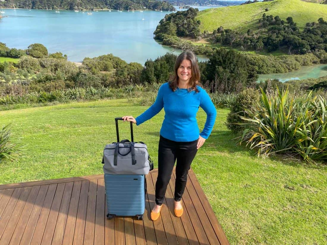 Wearing my Allbirds Tree Breezers flats with my Away luggage in Bay of Islands