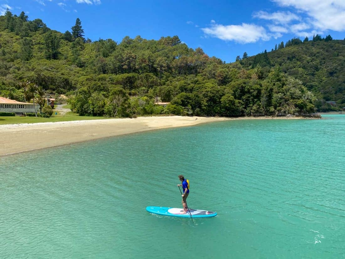 Simon standup paddleboarding at St Omer in the Marlborough Sounds
