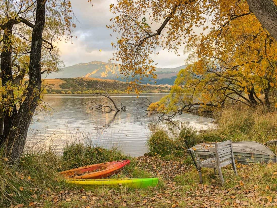 Kayakas and golden trees at Lake Hayes in autumn