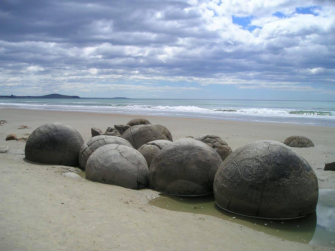 Moeraki Boulders Beach, one of the best road trip stops on the South Island East Coast in New Zealand