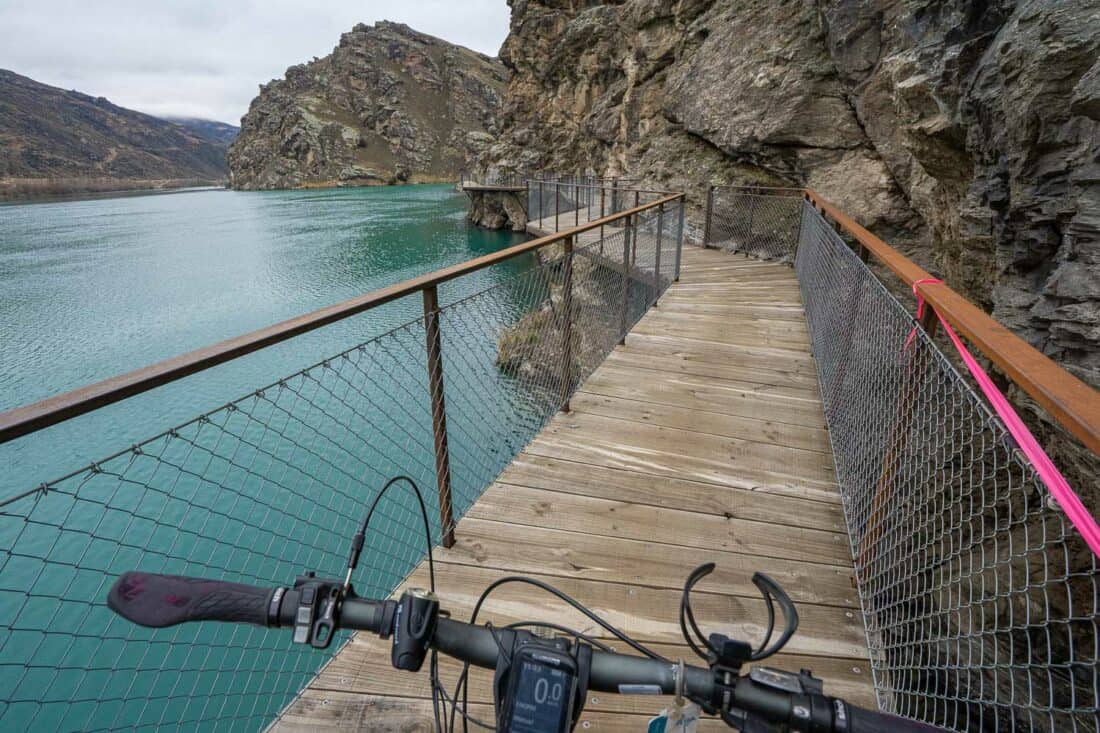 Cycling on a bolt on bridge on the Lake Dunstan Cycle Trail through Cromwell Gorge
