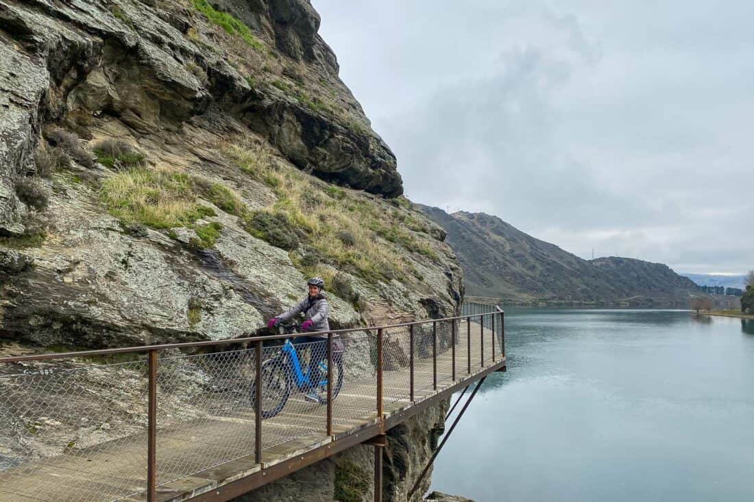 Cycling on a clip on bridge in the Cromwell Gorge section of the Lake Dunstan Cycle Trail