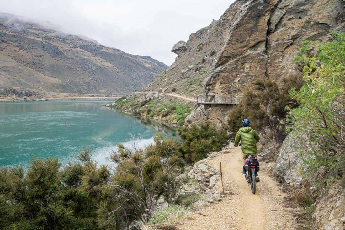 Cycling towards a bolt on bridge on the Lake Dunstan Cycle Trail through Cromwell Gorge