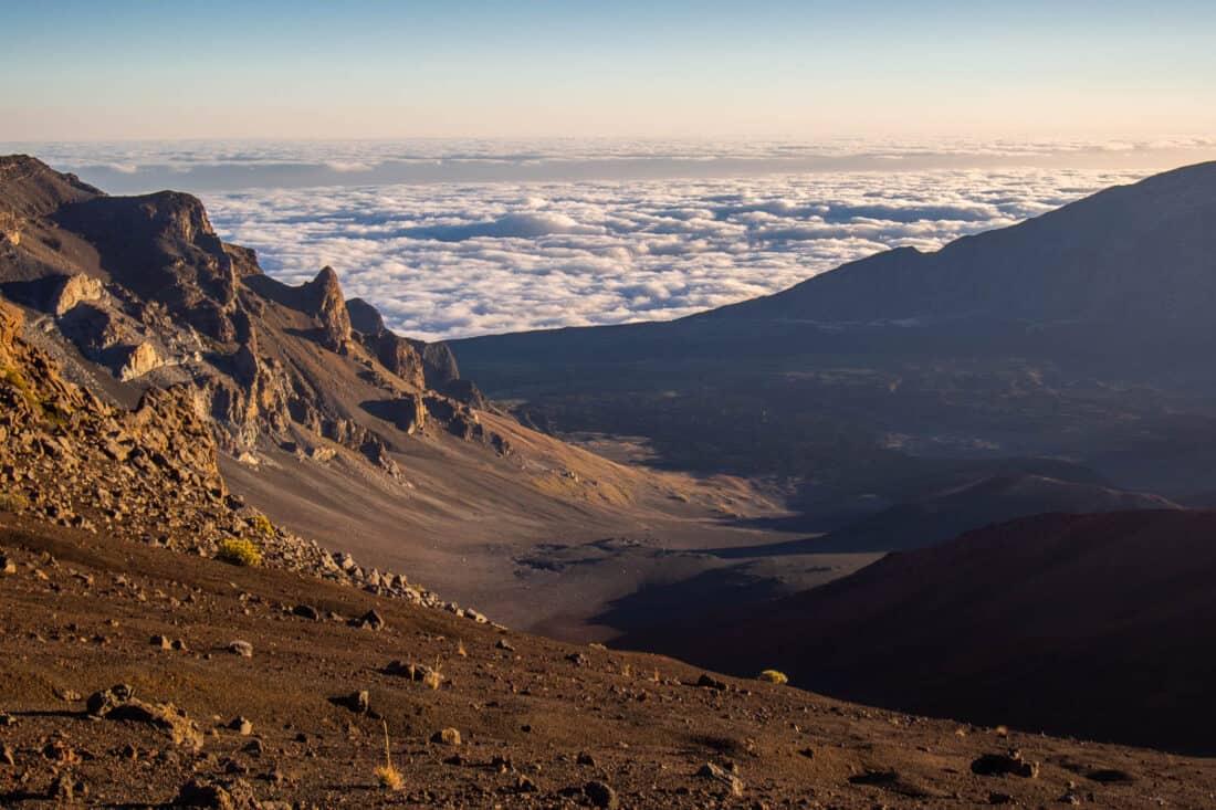 Watching the sunrise above the clouds at Haleakalā on Maui