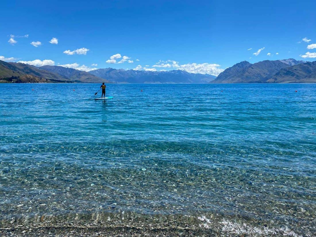 Simon stand up paddle boarding on Lake Hawea