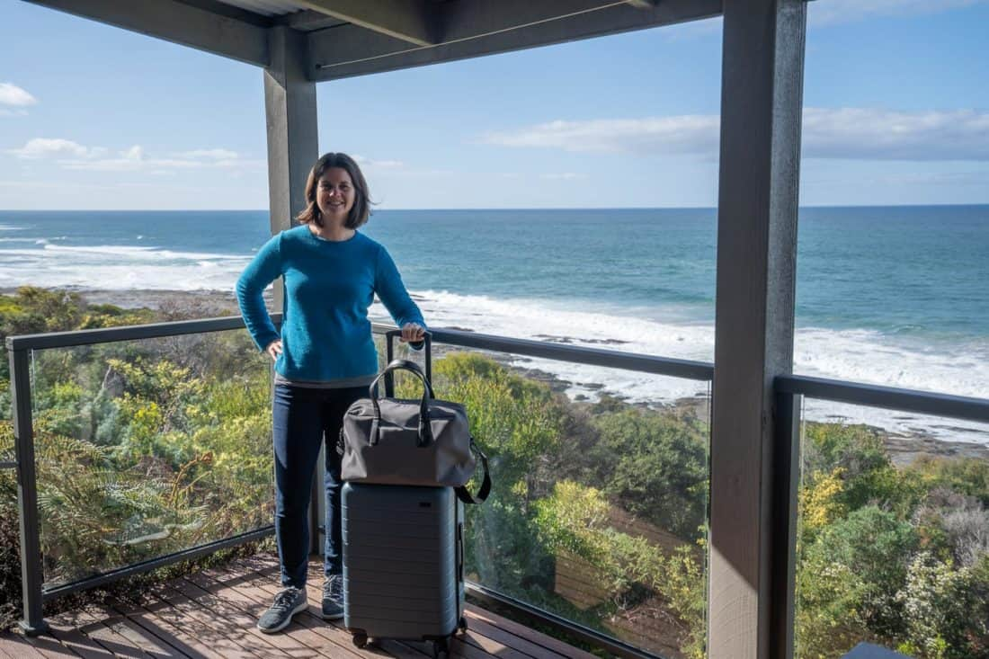 Erin with Away suitcase on Great Ocean Road