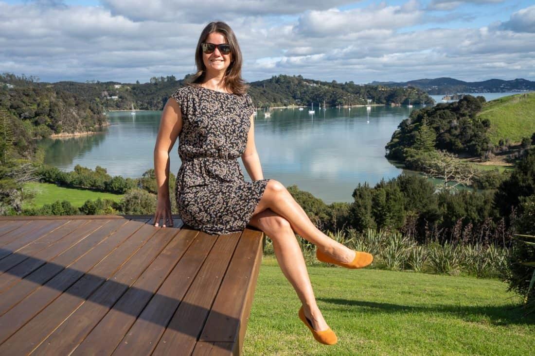 Erin wearing Allbirds Tree Breezers in Poppy on deck in Bay of Islands, New Zealand